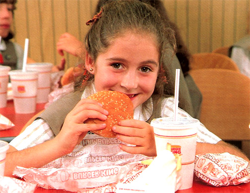 Girl Scout eating at Burger King in the 1980s